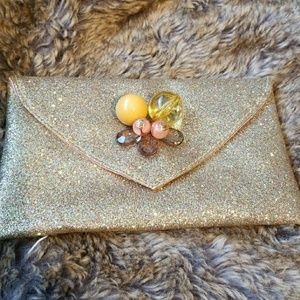 ANTHROPOLOGY GOLD GLITTERY CLUTCH